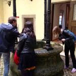 At another castle, Owen demonstrates how to make a 'duck fart', using a coin and a deep well.