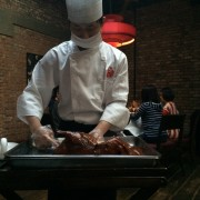 Waiter carves Peking duck at Duck De Chine